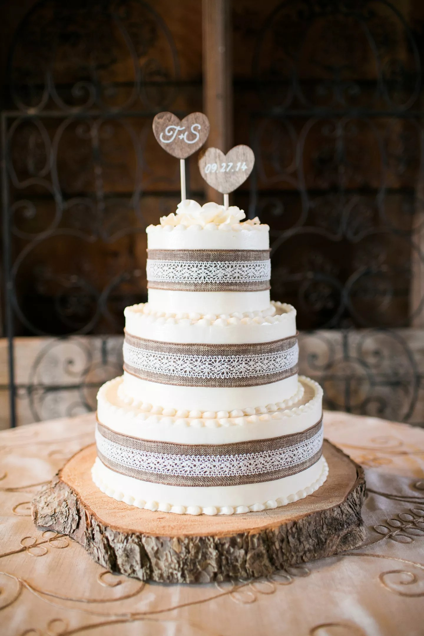 Wedding Cake With Burlap And Lace And Custom Wood Heart Topper