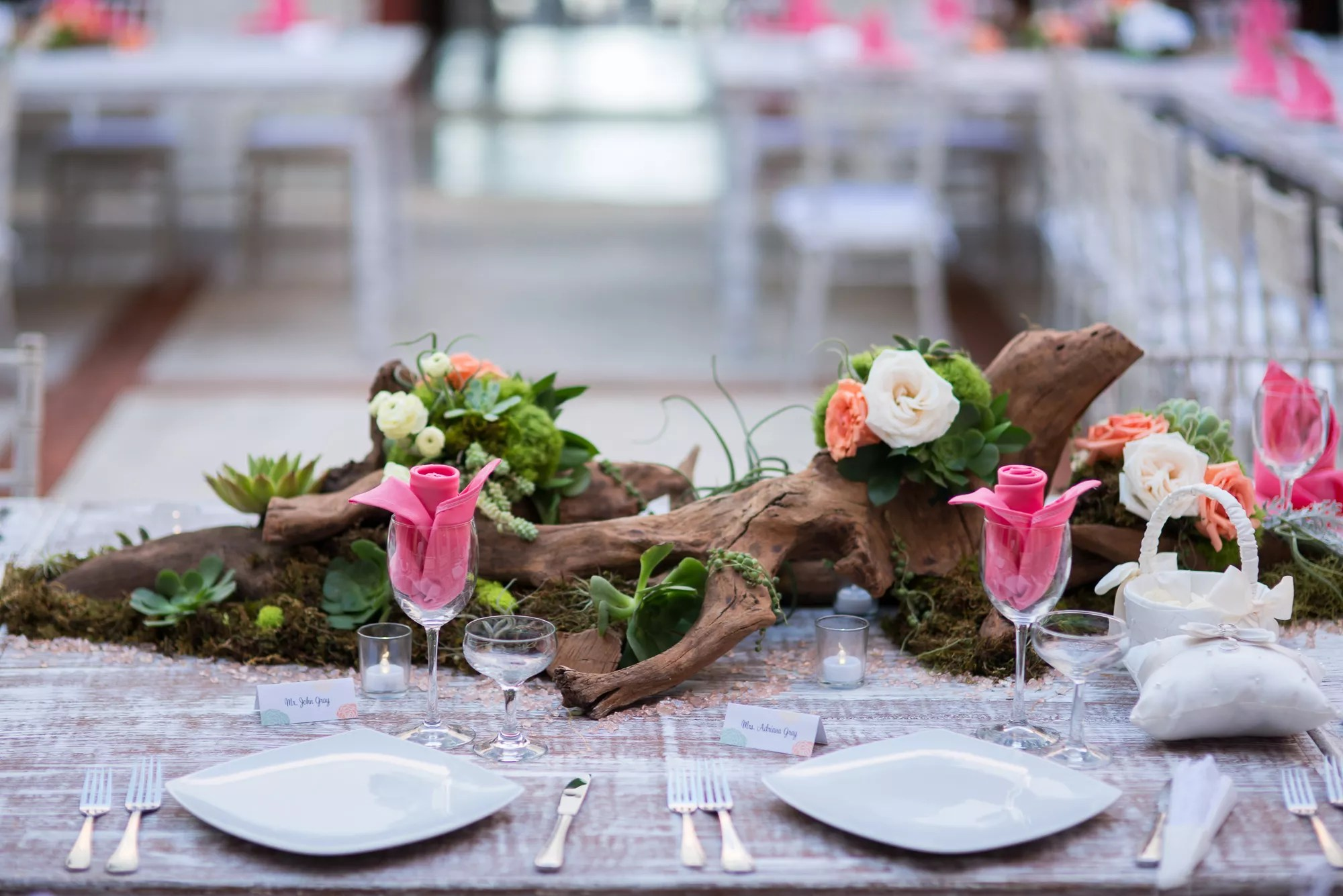 Driftwood Centerpiece With Roses Moss Succulents