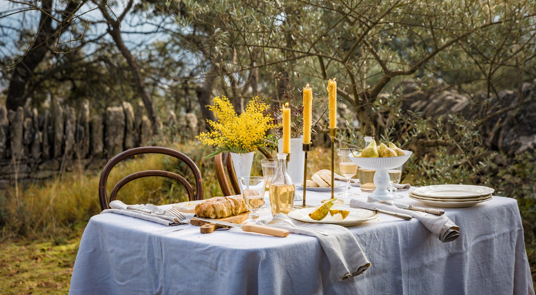 Winter table with acacia and beeswax candles apis cera