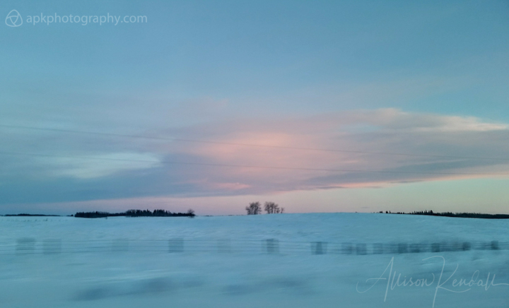Pink winter sunset clouds over the Manitoba prairie, Canada