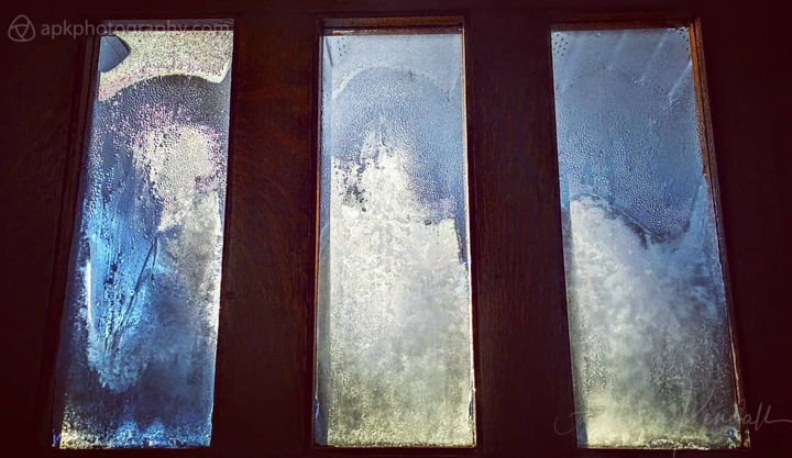 Iced-over windows of an old door, interior