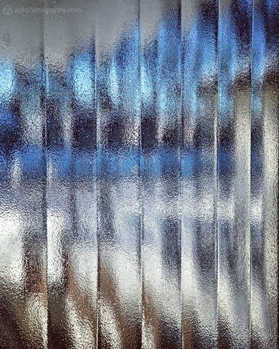 Winter colours through fluted-glass window