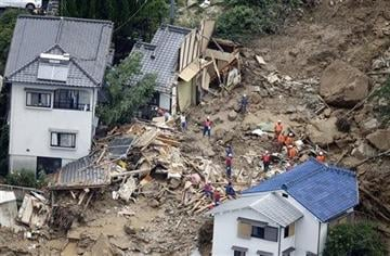 (AP Photo/Kyodo News). In this aerial photo, rescue workers search for survivors after a massive landslide swept through residential areas in Hiroshima, western Japan, Wednesday, Aug. 20, 2014.