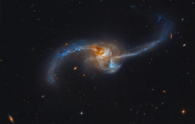 https://i0.wp.com/apod.nasa.gov/apod/image/1210/NGC2623_HLApugh.jpg?resize=660%2C420