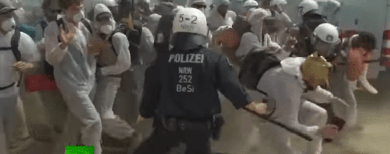 hundreds-of-anti-coal-protesters-clash-with-police-in-open-pit-mine-(video)