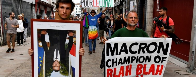 hundreds-protest-macron's-climate-policies,-carrying-stolen-portraits-of-him-upside-down