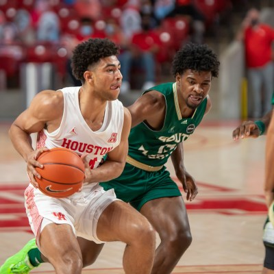 University of Houston guard Quentin Grimes attacks the paint against South Florida on Feb. 28 at Fertitta Center. (Andy Yanez)