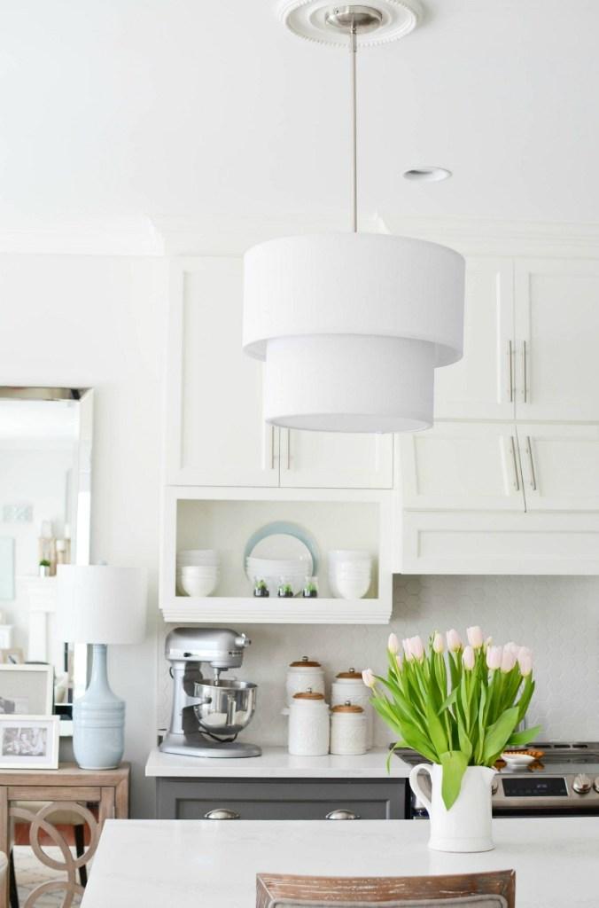 kitchen renovation white upper cabinets grey bottom cabinets