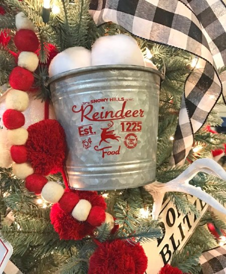 North Pole themed Christmas tree bucket of snowballs