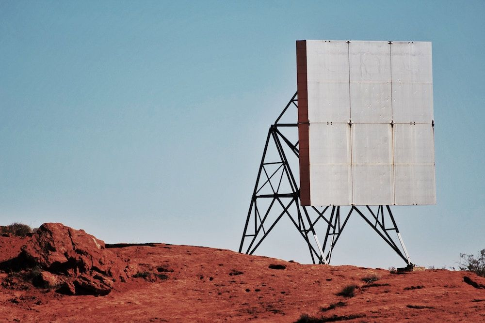 A structure on a barren patch of red dirt
