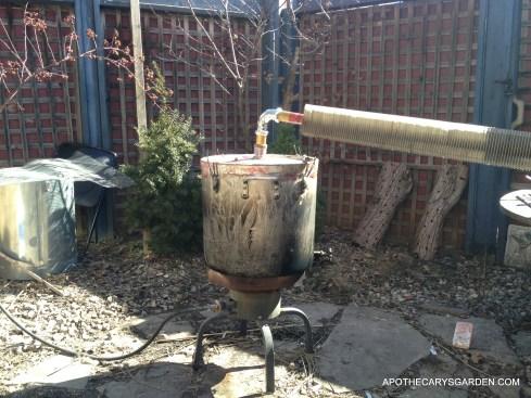 DIY Distillation-Home made Pot Still distilling Frankincense essential oils with an air cooled condenser.