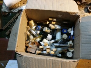 Bottles and test tubes with perfume trials,  experiments and explorations, won't come with me, back to the earth they go.