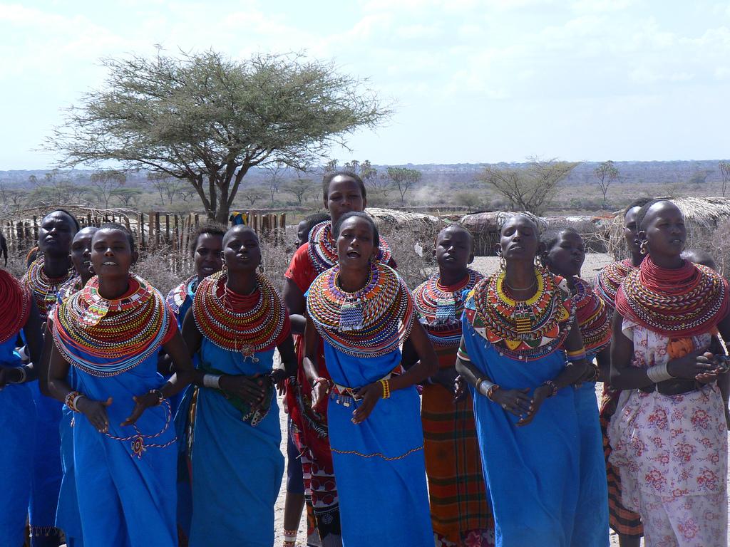 """""""Samburu women singing"""" by Wouter van Vliet - Flickr: P1010736. Licensed under CC BY 2.0 via Commons - https://commons.wikimedia.org/wiki/File:Samburu_women_singing.jpg#/media/File:Samburu_women_singing.jpg"""