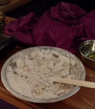 Stirring the fresh frankincense powder to keep it loose while it dries.