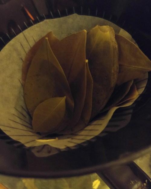 Straining the orange leaf infusion