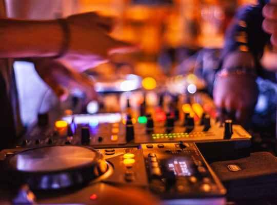person playing dj mixer