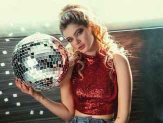 woman holding disco ball