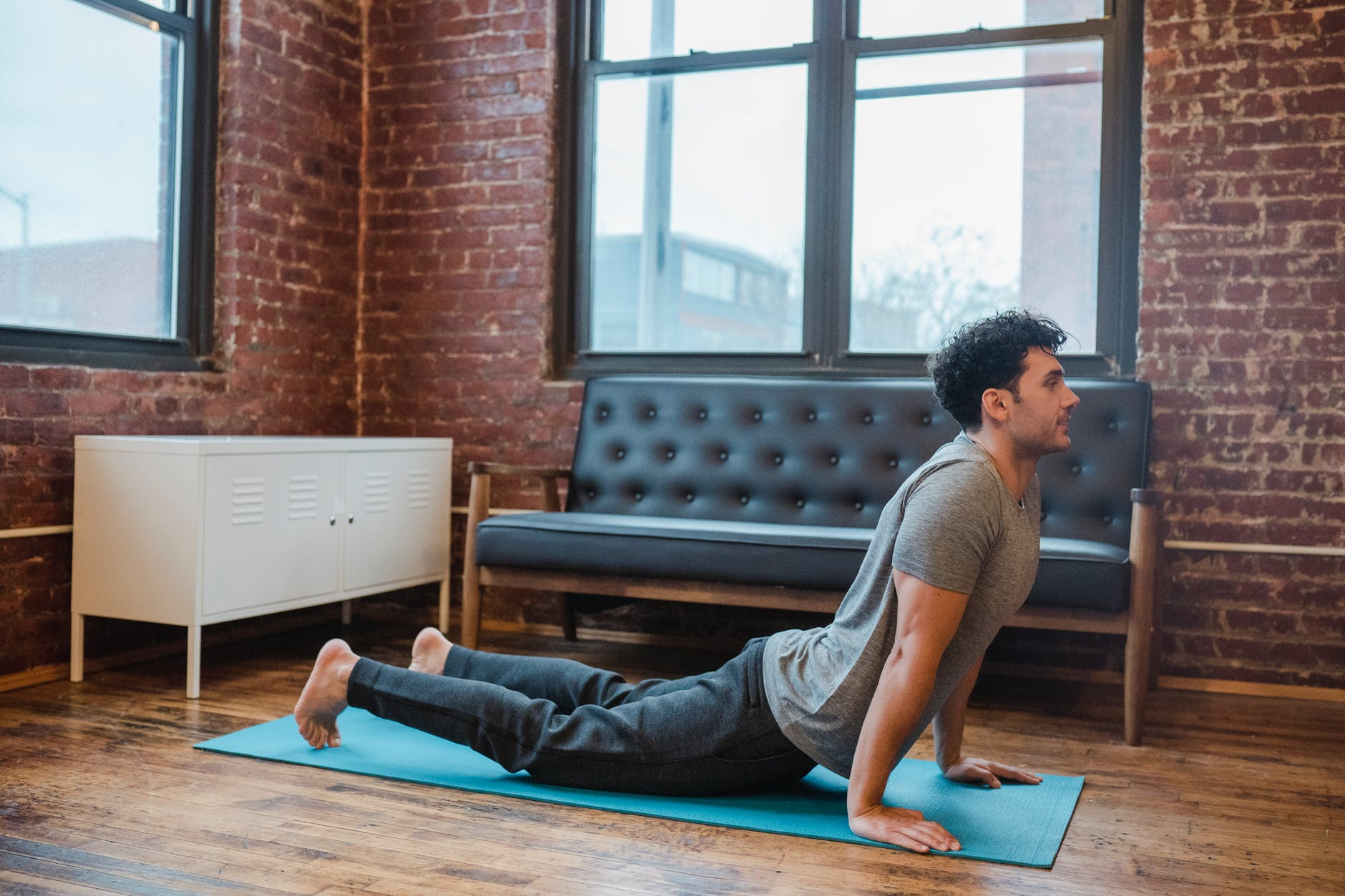 focused man bending back while practicing high cobra posture