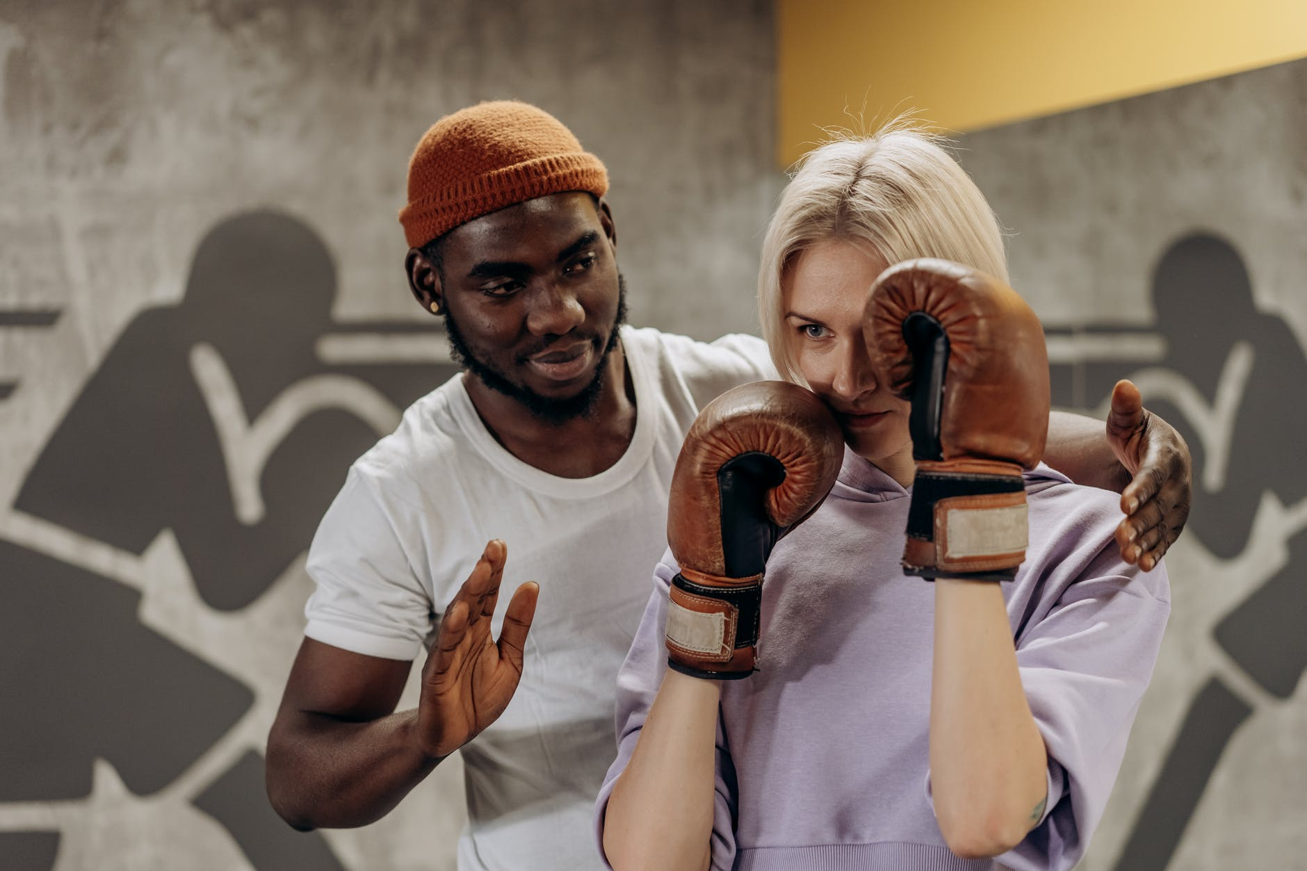 man training a woman in boxing