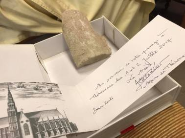 The pilgrimage was presented with a fragment of stone from the Cathedral of Théouranne which was destroyed in 1553