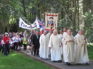 Procession up the drive to Pluscarden Abbey