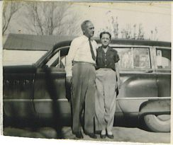 Ted and Maggie 1953, in front of our 1949 Buick station wagon