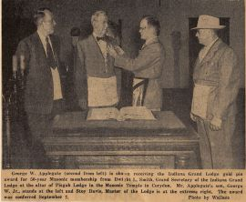 Newspaper clipping, Uncle Pud on left, Papa, to his right.