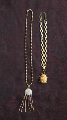Jellyfish and beetle necklaces