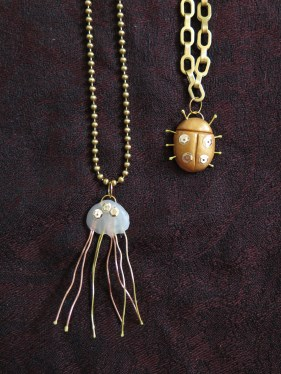 Jellyfish and beetle necklaces close-up