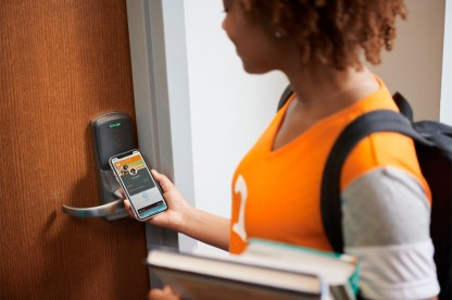 Apple-brings-student-IDs-to-iPhone-and-Apple-Watch-student-unlocking-door-with-iPhone-081319_carousel.jpg.large_2x