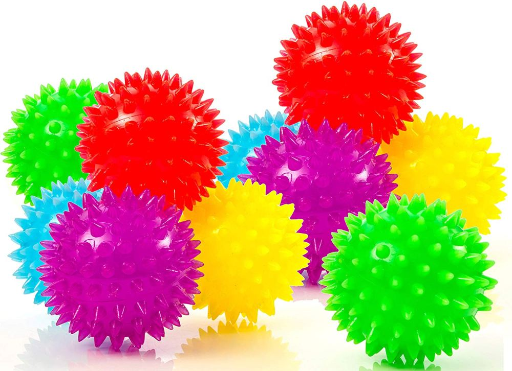 Holiday gift guide for babies 4 and 5 months old. The perfect holiday gift for babies 12 to 20 weeks old. Sensory balls that are great for throwing, rolling, and gripping.
