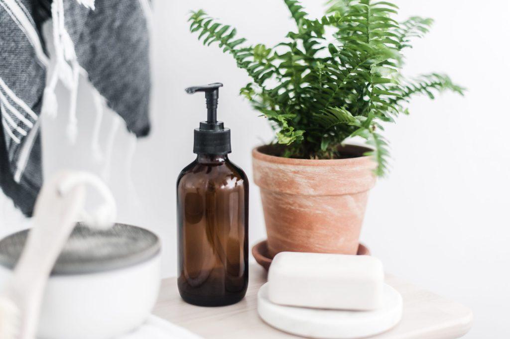 Glass soap pump in a bathroom