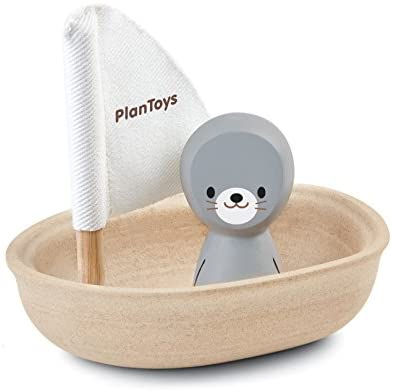 Adorable seal floating in a boat - a sustainable water toy for the ocean, lake, or bath time!