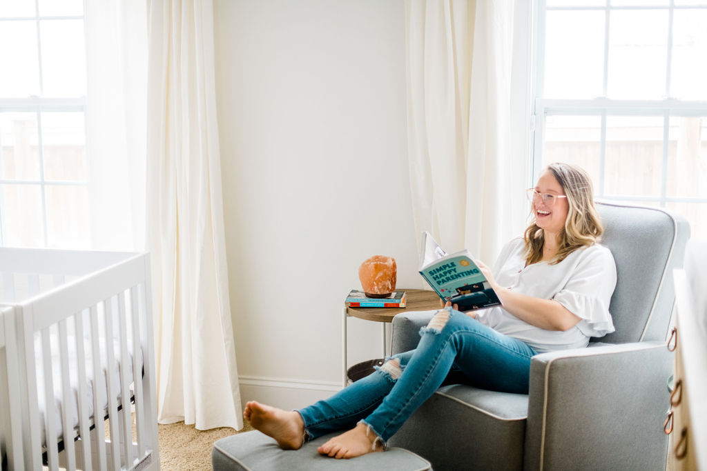Pregnant mom in rocker and glider for gender-neutral nursery for twins.