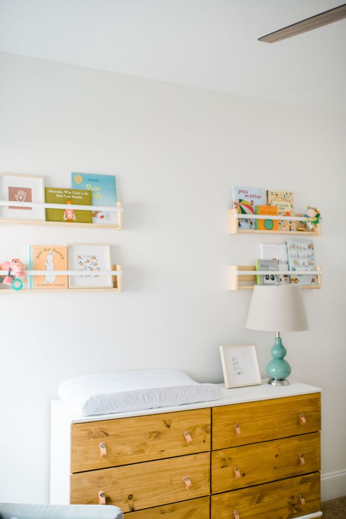 DIY Ikea Tarva Dresser painted white and the wood stained, with leather pulls. The perfect addition to a gender-neutral nursery for twins.