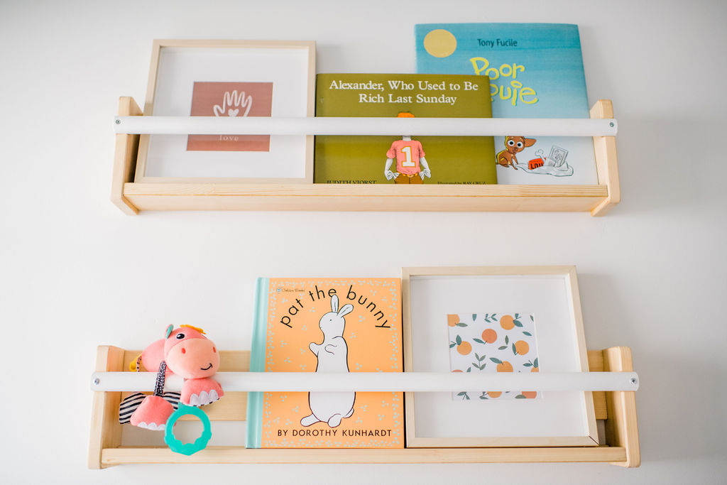 The Ikea Flisat Wall Storage as a bookshelf for this gender-neutral nursery for twins.