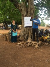 Rebecca and Honorable Tanimu give a presentation about the results of the Kukuo health screening to the community.