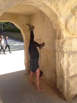Handstand in an old archway. This archway was for those on foot in the past. There was a bigger one for those on horse or in a carriage.