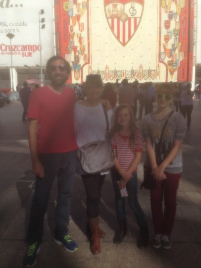 family in front of the stadium