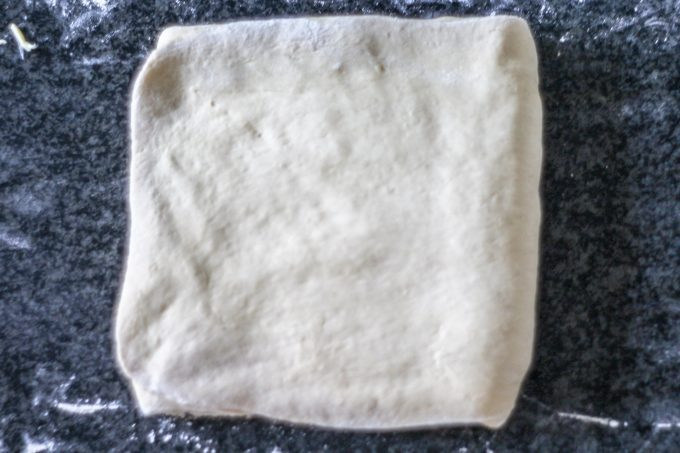 Final fold over chilled butter for pain au chocolat dough