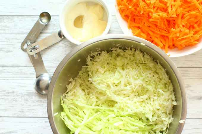 Grated carrot, cabbage and mayonnaise dressing