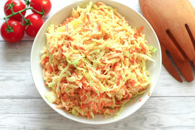piled high classic coleslaw in a serving bowl