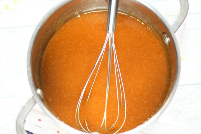 toffee sauce in a saucepan with a whisk