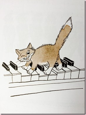 Chat sur un piano