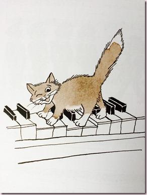 Chat sur un piano
