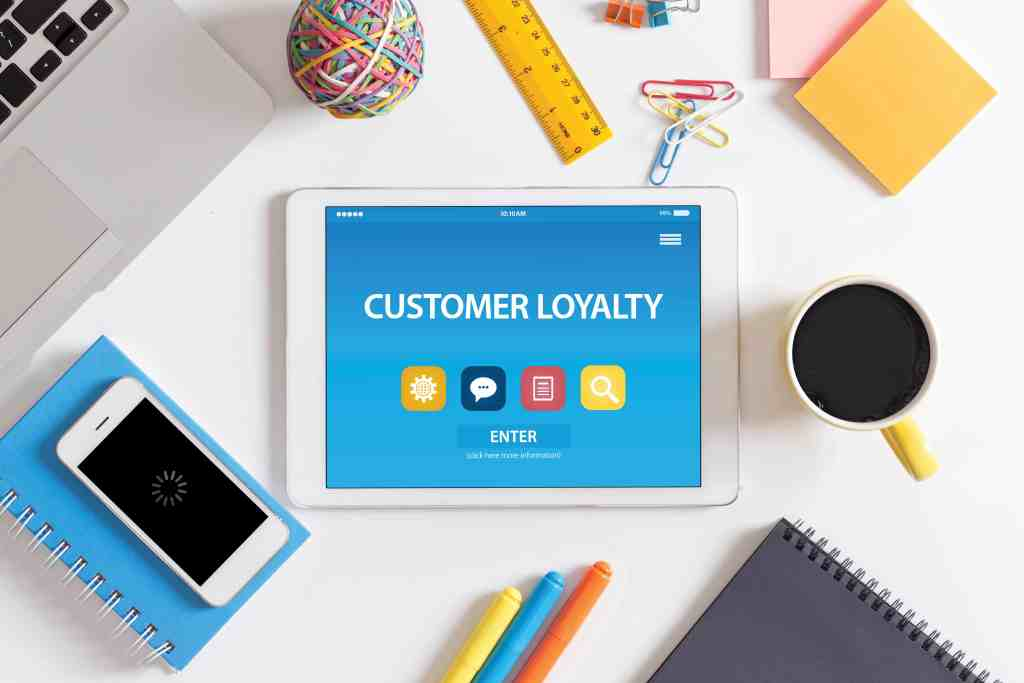 customer loyalty app concept displayed on a tablet