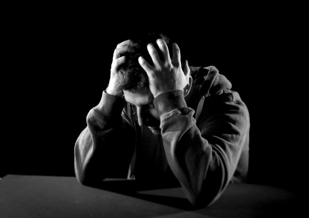 desperate man suffering emotional pain, grief and deep depression