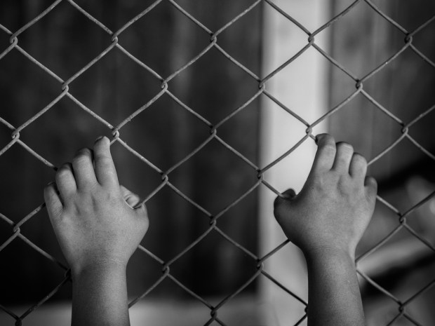 little girl hand holding on chain link fence for freedom, Human