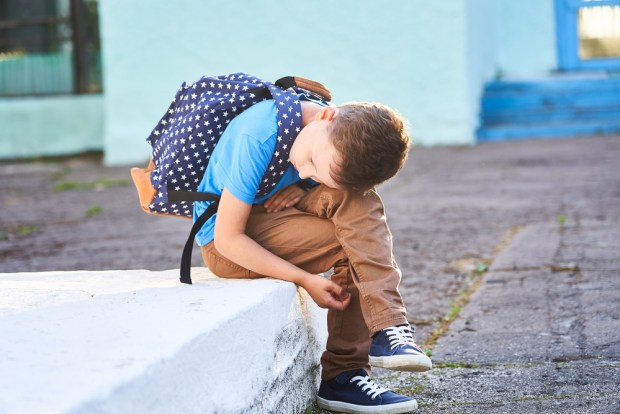 schoolboy is depressed. back to school. the first autumn day. th
