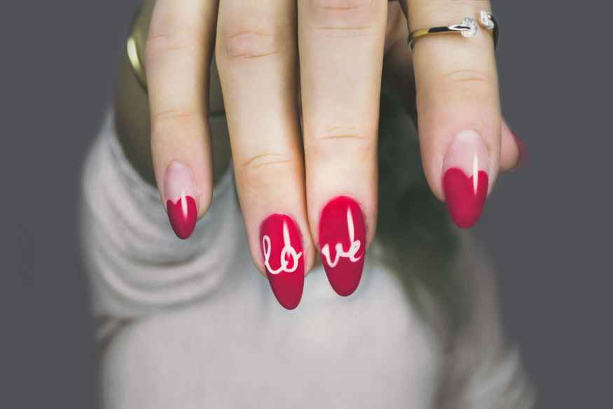 red and white manicure with love print